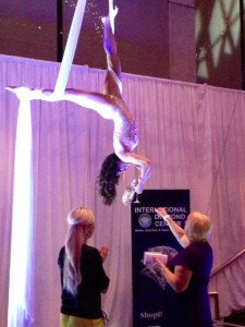 An aerial performer pours martinis