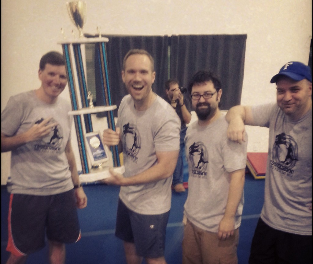 The 5th (some might say last) placed team eagerly snatches a 2nd place gymnastics trophy off the wall.